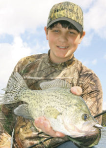 Jonathan Pizzolato shows why he enjoys fishing with his grandfather every chance he gets.