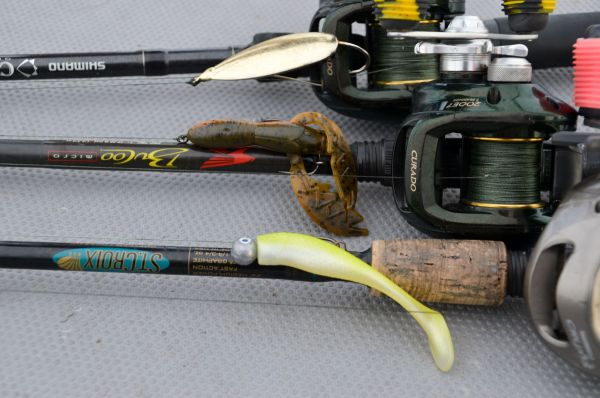 The three lures Stevie Nick uses exclusively are (top to bottom) a 1/2-ounce gold Johnson Sprite spoon, an Alabama craw-colored NetBait Baby Paca Craw on a 1/4-ounce Rockport Rattler jighead and a lemonhead-colored Matrix Shad on a 1/4-ounce Goldeneye jighead.
