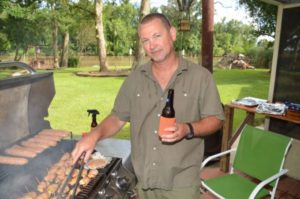 Dennis loves to work the big grill in the Menard's backyard on the Vermilion River.