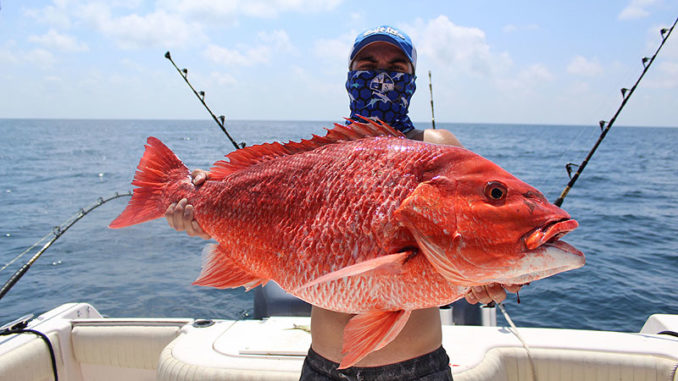 Andrew Duval, 17, of Patterson with a red snapper caught 120 miles into the Gulf from Berwick.