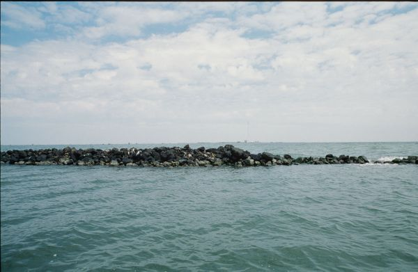 Finding rock piles away from the main stretch of a jetty is one key to finding speckled trout sweet spots.
