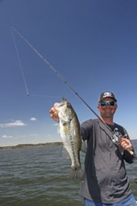 Pulling a small worm behind a rumbling Carolina rig defines heavy finesse.