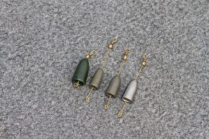 Breakaway drop-shot weights allow you to fish this finesse rig in heavy cover with less risk of losing the entire rig.