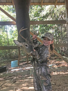 Sawyer Elizabeth Mumford, 7, shot her first deer on opening morning of the early youth season, Oct. 27, 2018, at her family's hunting club in Jackson.