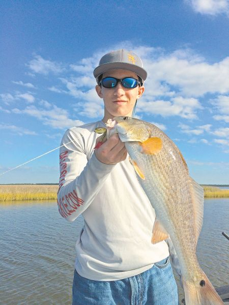 Live bait is a summertime staple along the marsh, but all you need to catch reds is a jig and your favorite plastic.