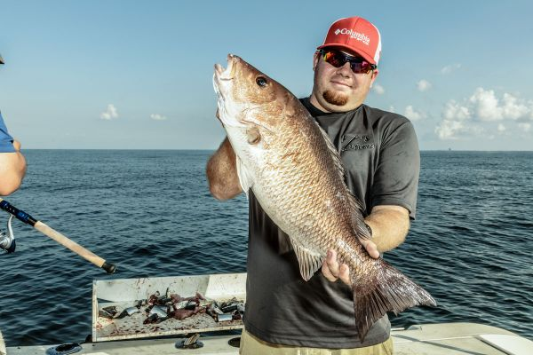 TJ Roussell figured out the best way to catch mangrove snapper on this trip was to soak his bait as long as possible.