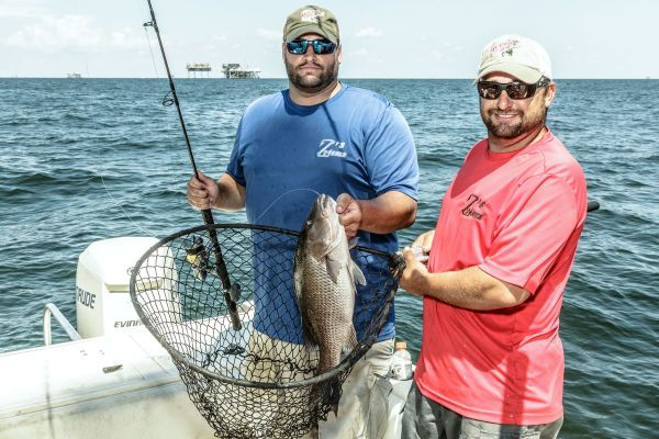 Joey and Lane Zimmer like to spend time chasing mangrove snapper on the first rigs below Grand Isle when they aren't inshore chasing trout and reds.