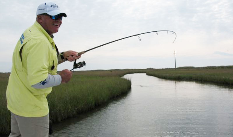 Bergeron changes his reaction to a strike depending upon the live bait he's using. With live shrimp he'll just set the hook, but with croakers he waits until he feels his line tighten up.