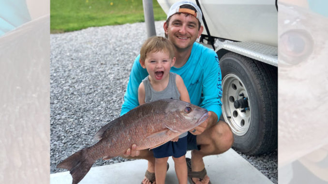 Andrew Suffrin pictured with his son, Drew, after a mangrove snapper trip out of Grand Isle over the July 4 weekend.