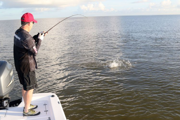 This angler puts the heat on a big red that fell for a topwater walker that looked like a mullet.