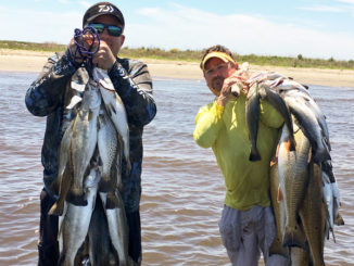 Sammy Romano, left, and Cabot Corso enjoyed an epic day in the surf at Elmer's Island last April, catching limits of specks using suspended jerkbaits.