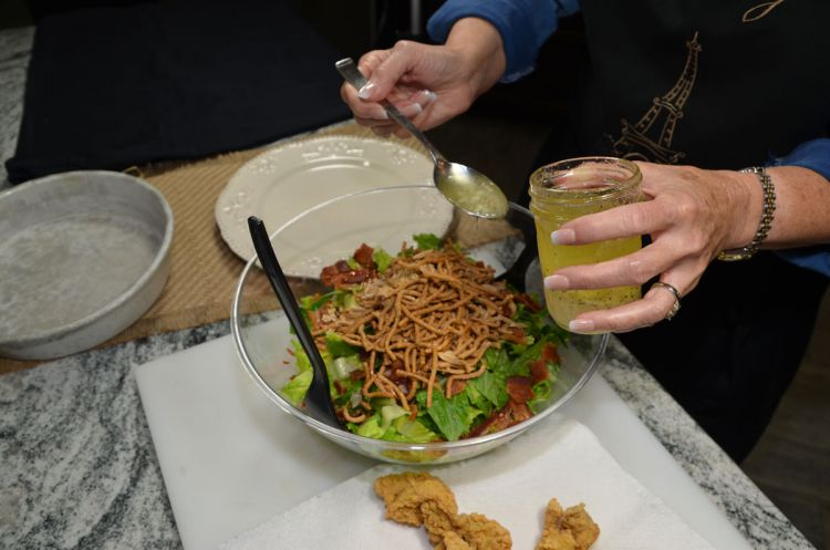 Debbie prepares her family's salad with Asian ingredients and fried oysters.