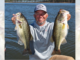 Guide Darold Gleason shows off a couple of nice bass up at Toledo Bend.