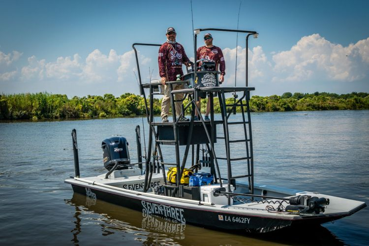 Tower boats don't just provide an elevation advantage while fishing. Because the boat's controls are also located on the tower, Jeff and Jake are able to scout for fish while running between spots.