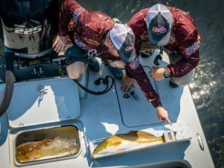 "A redfish tournament is a game of fractions of an inch. A ""perfect pincher"" slid over a redfish tail can make the difference in ensuring a big red doesn't break the slot."