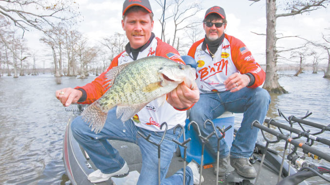 Steve Coleman landed this crappie while he and Ronnie Capps push-poled jigs around cypress knees.