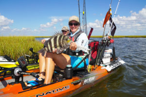 Jessica Thompson Bryant shows off a big sheepshead that couldn't resist a dead shrimp.