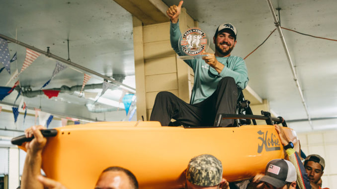 Devon Beltz gets the traditional ride in his new kayak as the winner of BCKFC's Fall 'N Tide kayak fishing tournament.