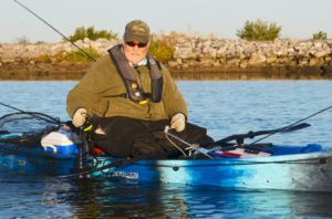 Tedesco is a fan of an anchoring system that has a 10-pound mushroom anchor clipped with a carabiner clip onto a trolley system that runs the length of his kayak. Once the anchor is set, he can slide it on the trolley for perfect casting position in the wind. The trolley system's black lines are clearly visible here.