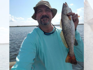 Joey Jeanfreau shows off a nice speckled trout, and said Chalmette locations typically get hot from October through about April.