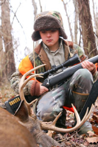 The trick to killing big bucks off mock scrapes is to set up where you can spot bucks checking them from downwind.