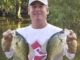 Bill McCarty holds two slabs caught in the Stephensville area.