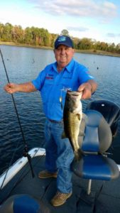 "Lonnie Stanley grabs a big bass that bit his new, reintroduced ""Code-Red"" VibraWedge spinnerbait."