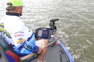 "Wally ""Mr. Crappie"" Marshall closely monitors his electronics as he jigs over brush piles."