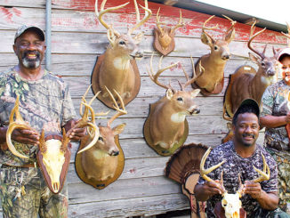 From left, William, Lionel and Jenni Washington show off some of the family's recent Louisiana whitetail trophies.