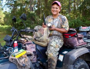 Jenni Washington, a.k.a. 'Annie Oakley,' shows what she packs for a long day in the deer stand.
