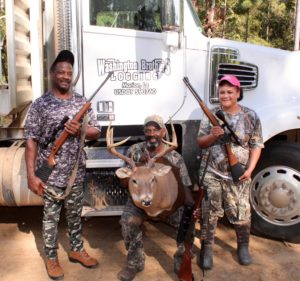 From the left, Lionel, William and Jenni Washington illustrate that time spent in the woods working can definitely lead to success in the deer stand.