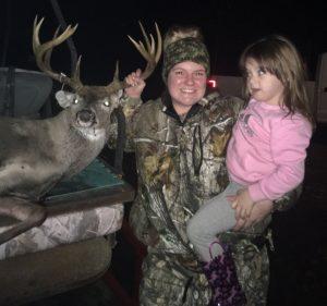 Bethany Gunter and her 2-year-old daughter Malia pose with the big Kisatchie 12-point buck Gunter shot on Dec. 11 in Winn Parish.