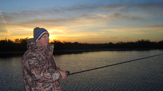 Tommy Vidrine looked more like a duck hunter than a trout fisherman as he casts south of Highway 1 near Grand Isle in pursuit of roadside specks.