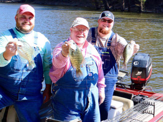 """The Maxwells in official fishing clothing along with """"Team Overalls"""" boat logo and all."""