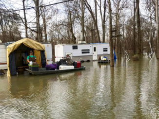 Tensas Parish deer hunters removed gear from their campers as flood waters rose in January. Even mobile camps like these got flooded because before water rose quickly, and roads went under and were closed.