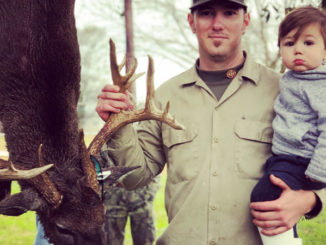 Dillon Savoy and his 16-month-old son Ryder pose with the big buck he shot on Jan. 17 at the White Castle Hunting Club in Iberville Parish.