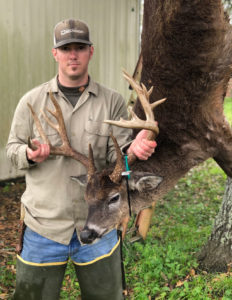 Dillon Savoy, of St. Amant, poses with the big 15-point buck he killed at close-range on the White Castle Canal spoil bank on Jan. 17. The big buck grossed more than 163 inches of bone.