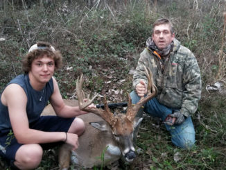 Scotty Smith, right, and his son Hunter take a picture after Scotty dropped this 190-class typical buck in Avoyelles Parish on Jan. 1.
