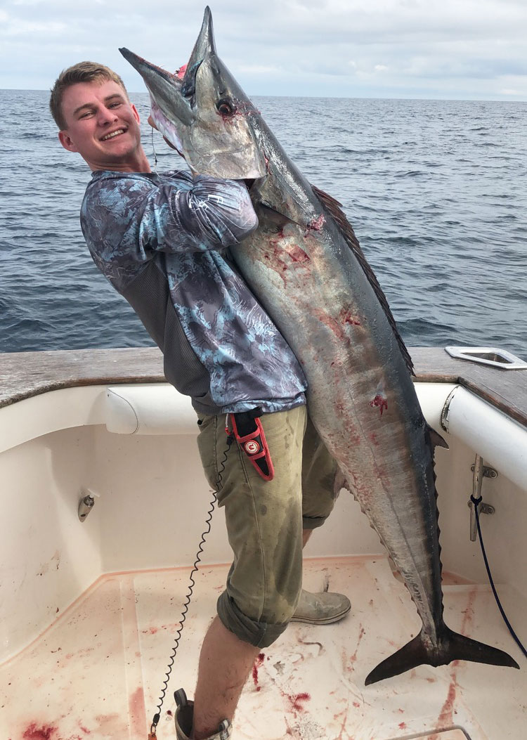 Tyler Hatrel shows off a 67-inch wahoo caught earlier this year about 90 miles south of Fourchon. Hatrel estimated this fish weighed between 75 and 85 pounds.