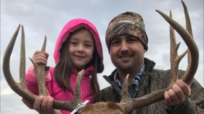 Benji Nelson and his 7-year-old daughter, Rylee, pose with the big 12-point Catahoula Parish buck he shot on Dec. 29 near Sicily Island.