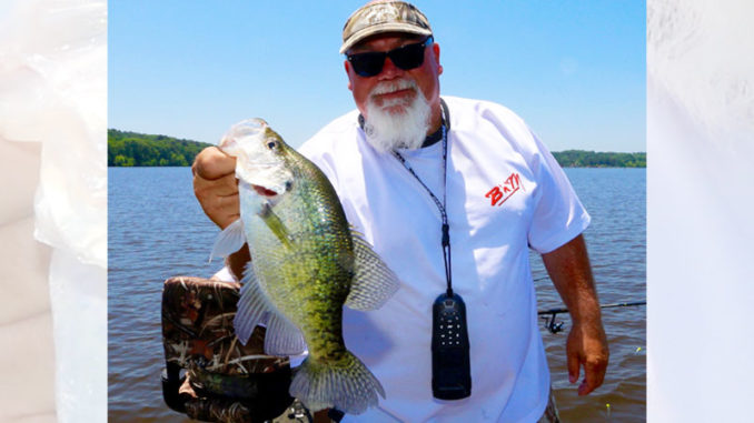 "John Godwin with a slab crappie from Lake D'Arbonne on ""hump day."""