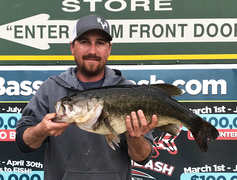 Aaron Gay, of Princeton, poses with the 10.26-pound bass he caught in Housen Bay on March 20.