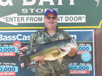 Darren Burns, of Moss Bluff, shows off the 10.27-pound lunker bass he landed on March 20 near Mill's Creek — the first of four lunkers landed on what proved to be an epic day at Toledo Bend.