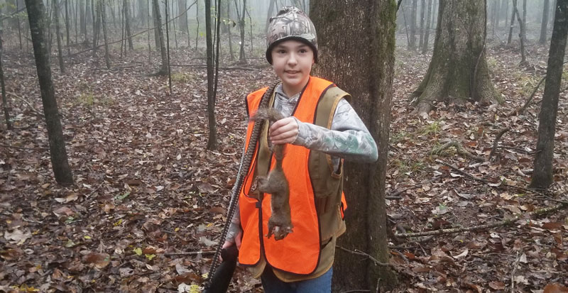 Youth Hunter of the Year male winner Evan Alderson of Sulphur with a squirrel.