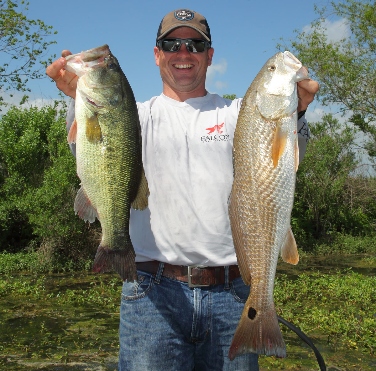Mike McCorkel with a good Penchant largemouth and redfish. Both fish are caught in the brackish waters.