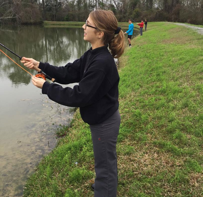 Anna Crifasi casts her fly line in hopes of hooking up on her first fish on fly rod. A senior at St. Michael, Anna is excited about being on the school's new fly fishing club.