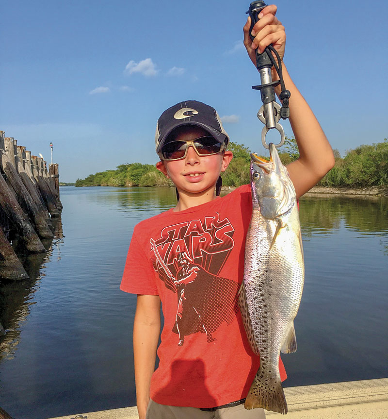 Cyrus Sloane Jr. hooked his first keeper speckled trout in Grand Chenier.