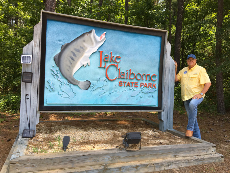 Louisiana State Parks Assistant Secretary Gene Reynolds stands at the entrance to Lake Claiborne State Park.