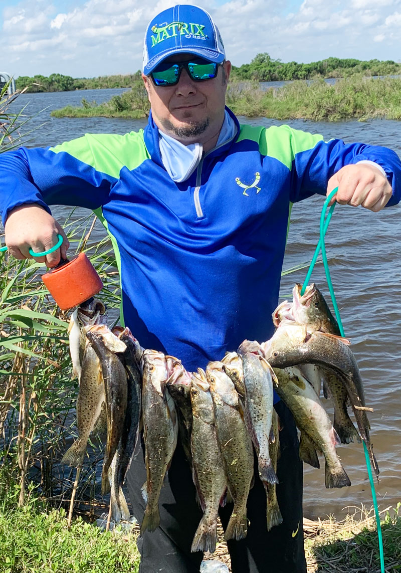 Reggie Legendre of Lafourche with a limit of trout he caught while bank fishing down LA 1.