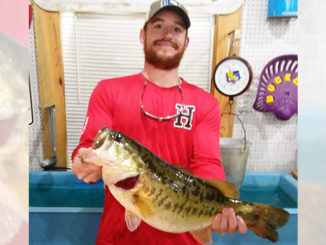 Garrett Perkins, of Mamou, poses with the big 10.46-pound bass he caught from a bed on March 25 in the Negreet area at Toledo Bend. The big fish finally bit a Texas-rigged white Cajun Lures Craw after about 25 or 30 flips, he said. (Photo courtesy of Toledo Bend Lake Association)